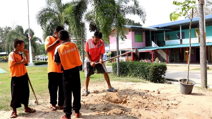 Volunteers Group 9099 clean up Mabprachan School as part of their community service program.