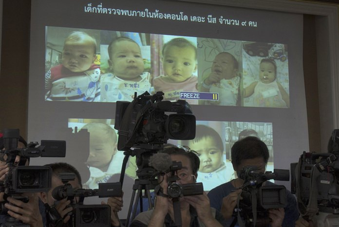 In this Aug. 12, 2014, file photo, the media attend a press briefing where Thai police display projected pictures of surrogate babies born to a Japanese man who is at the center of a surrogacy scandal during a press conference at the police headquarters in Chonburi. The Japanese father of the surrogate babies Mitsutoki Shigeta is the son of the founder of Japanese telecom and insurance company Hikari Tsushin and earns millions of dollars a year in dividends. (AP Photo/Sakchai Lalit, File)