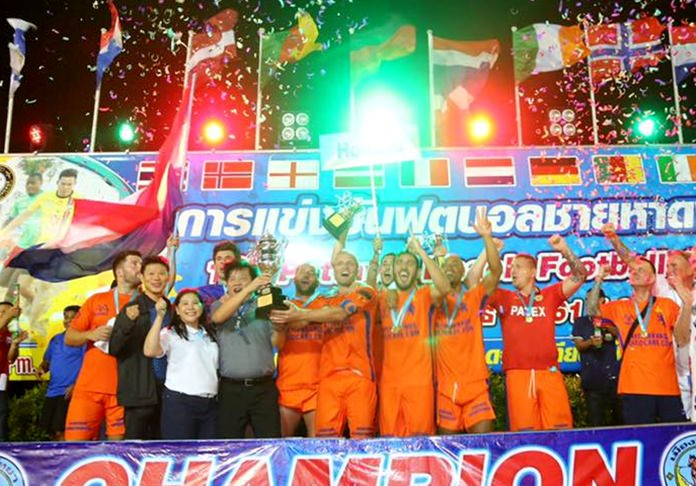 The Dutch male football team celebrate after winning the 13th Pattaya Beach Football Cup.