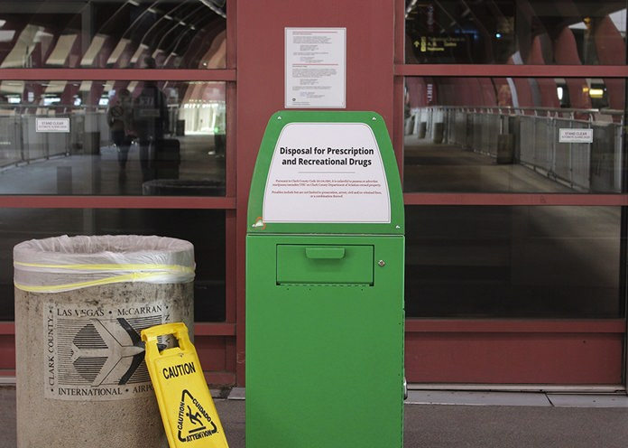 """A metal container designed for """"Disposal for Prescription and Recreational Drugs,"""" sits outside one of the entrances to McCarran International Airport in Las Vegas, Thursday, Feb. 22. (AP Photo/Regina Garcia Cano)"""