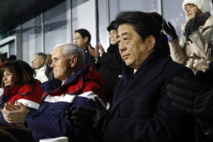 In this Feb. 9, 2018, file photo, Japanese Prime Minister Shinzo Abe, right, sits alongside Vice President Mike Pence, center, and second lady Karen Pence at the opening ceremony of the 2018 Winter Olympics in Pyeongchang, South Korea, Friday, Feb. 9, 2018. (AP Photo/Patrick Semansky, Pool)