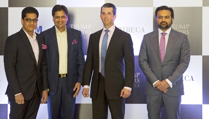 The eldest son of U.S. President Donald Trump, Donald Trump Jr., second from right, poses with promoters of Trump Towers Pankaj Bansal, left, Basant Bansal of M3M developers and Kalpesh Mehta, right, of Tribeca developers at a photocall in New Delhi, India, Tuesday, Feb. 20, 2018. Trump Jr. is in India to help sell luxury apartments and lavish attention on wealthy Indians who have already bought units in a string of Trump-branded developments. (AP Photo/Manish Swarup)