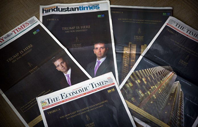 """The eldest son of US President Donald Trump, Donald Trump Jr's Trump Towers ads are seen in major newspapers in New Delhi, India, Tuesday, Feb. 20, 2018. """"Trump has arrived. Have you?"""" shout the barrage of glossy front-page advertisements in almost every major Indian newspaper. (AP Photo/Manish Swarup)"""
