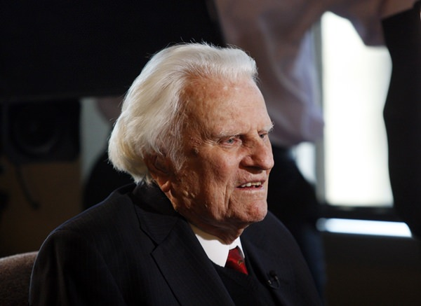 In this Dec. 20, 2010 file photo, evangelist Billy Graham, 92, speaks during an interview at the Billy Graham Evangelistic Association headquarters in Charlotte. (AP Photo/Nell Redmond, File)