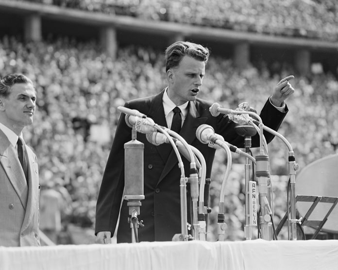 In this June 27, 1954 file photo, Evangelist Billy Graham speaks to over 100,000 Berliners at the Olympic Stadium in Berlin, Germany. (AP Photo, File)