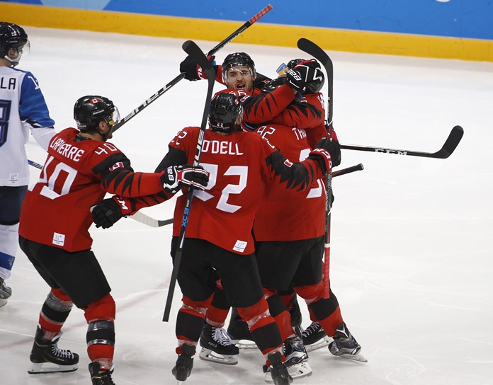 Maxim Noreau (56), of Canada, celebrates with his teammates after scoring a goal against Finland during the third period of the quarterfinal round of the men's hockey game at the 2018 Winter Olympics in Gangneung, South Korea, Wednesday, Feb. 21, 2018. (AP Photo/Jae C. Hong)