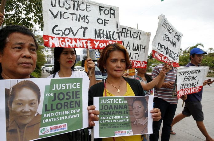 In this Wednesday, Feb. 21, 2018, file photo, protesters picket the Senate at the start of the probe in the death of an overseas worker in Kuwait, Pasay city south of Manila, Philippines. (AP Photo/Bullit Marquez)