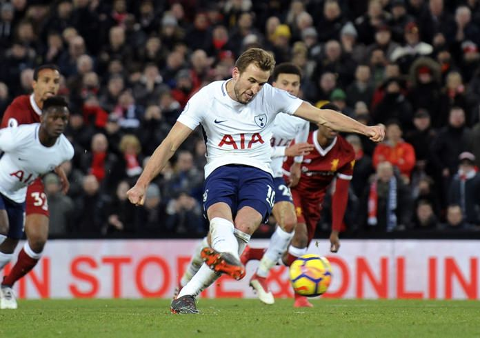 Tottenham's Harry Kane scores his side's second goal during the English Premier League match against Liverpool at Anfield stadium in Liverpool, Sunday, Feb. 4. (AP Photo/Rui Vieira)