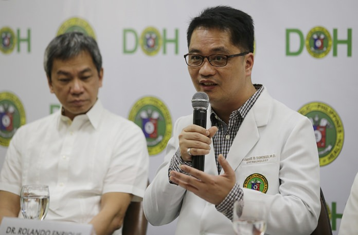 Department of Health Undersecretary Dr. Rolando Enrique Domingo, right, gestures besides Philippine General Hospital Director Dr. Gerardo Legaspi, during a press conference at the Department of Health office in Manila, Philippines on Friday, Feb. 2. (AP Photo/Aaron Favila)
