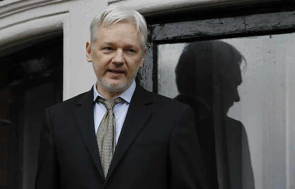 In this Feb. 5, 2016 file photo, WikiLeaks founder Julian Assange appears on the balcony of the Ecuadorean Embassy in London. (AP Photo/Kirsty Wigglesworth)