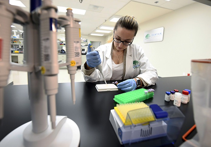 Product development scientist Veronika Shevchenko works with patient samples at Banyan Biomarkers Tuesday, Feb. 13, 2018, in San Diego. The company is developing a blood test to help doctors diagnose traumatic brain injuries. (AP Photo/Denis Poroy)