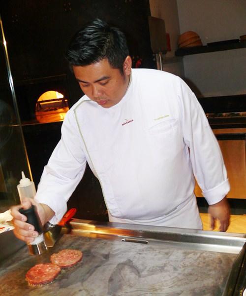 Chef Tofu preparing his burger.