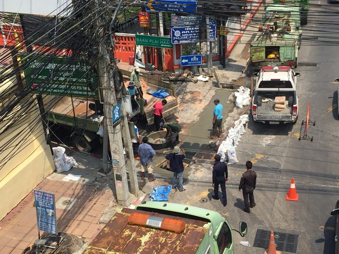 Drain covers and potholes were repaired in Soi Naklua 16 to prevent accidents.