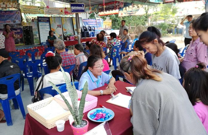 Soi Korphai Community residents receive small dividends from the neighborhood's community fund aimed at supporting businesses and people in debt.
