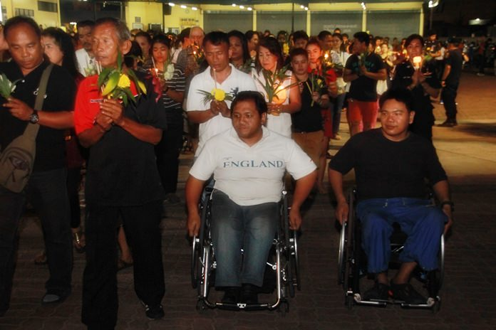 Wheelchair bound residents show their faith as well.