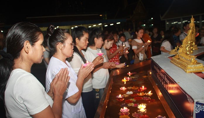 Residents purge their bad deeds and sinful behavior from the previous year by lighting little floats and placing them at the feet of Lord Buddha.