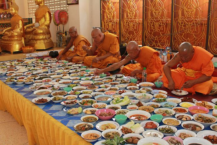 After the prayer sessions, monks partake in their daily meal offered by devout Buddhists.