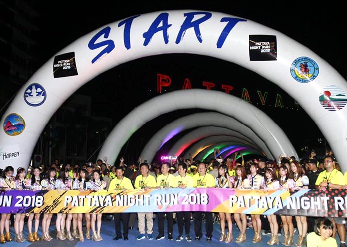 Runners and public officials line up at the start/finish area at Bali Hai Pier.