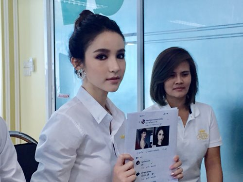 Reigning Miss Tiffany Universe Rinrada Turapan looks sad while reporting someone created a copycat profile claiming the transgender beauty queen would marry anyone for 2 million baht.