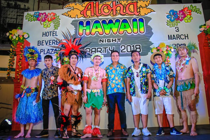 Managing Director Yod Boonyasatit (center) takes the stage with his Polynesian attired staff.