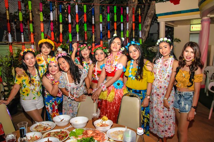 Grass skirts and aloha muumuus were the preferred dress for women during the party.