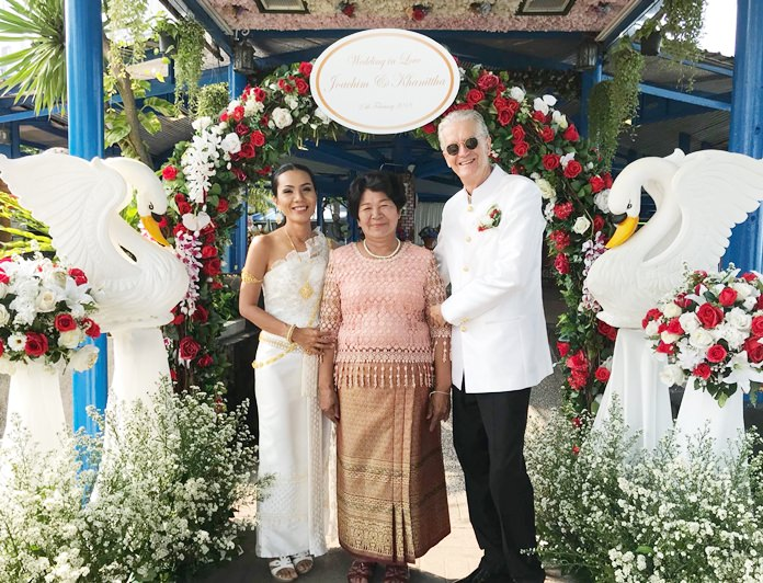 Jo and Noi receive blessings from Khun Mae Wang the bride's mother.