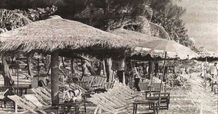 Pattaya Beach circa 1994, with its thatched umbrellas and tropical feeling.