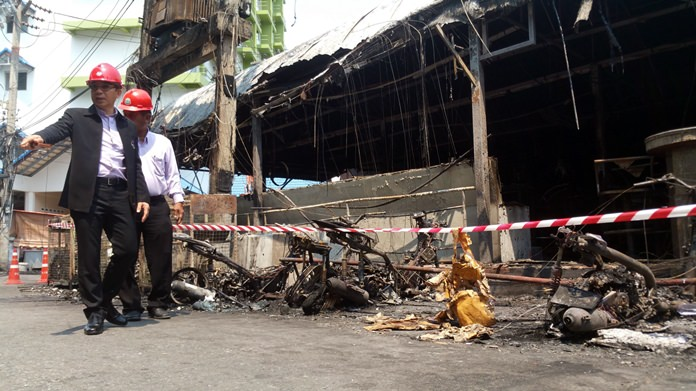 Regional PEA chief Chartchai Pumrin and Pattaya office head Nirtuh Charoenchop toured the fire-ravaged area behind the Marine Plaza hotel. The guilty transformer can be seen above and behind them.