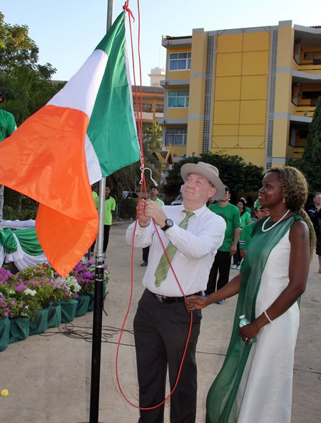 Lowering the flag of Ireland at the end of the day.