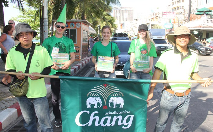 Carrying the flag of Chang, one of the parade sponsors.