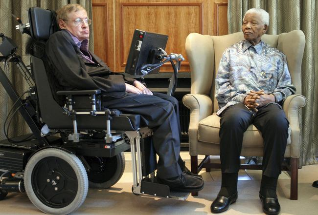 In this Thursday, May 15, 2008 file photo former South African President Nelson Mandela, right, meets with British scientist Professor Stephen Hawking, left, in Johannesburg. (AP Photo/Denis Farrell, File)