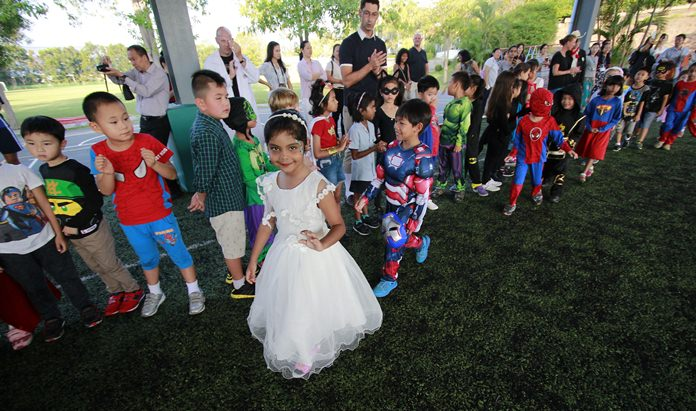 A parade of the superheroes was colourful and fun.