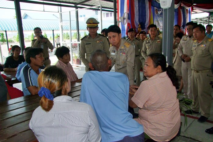 Gov. Pakarathorn Thienchai talks with a family during this year's visitation day for inmates' close relatives at Chonburi Central Prison.