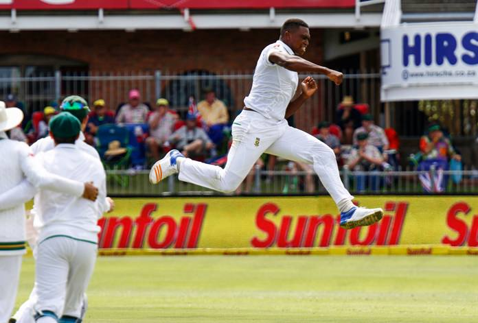 In this photo taken Friday March 9, South Africa's Kagiso Rabada celebrates taking a wicket on the first day of the second cricket test between South Africa and Australia at St. George's Park in Port Elizabeth, South Africa. (AP Photo/Michael Sheehan)