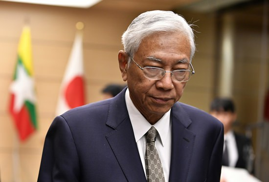 In this Dec. 14, 2017, file photo, Myanmar's President Htin Kyaw looks down as he leaves a joint press conference with Japan's Prime Minister Shinzo Abe at the Prime Minister's official residence in Tokyo. (Franck Robichon/Pool Photo via AP)