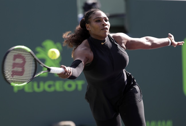 Serena Williams returns to Naomi Osaka, of Japan, during the Miami Open tennis tournament, Wednesday, March 21, in Key Biscayne, Fla. (AP Photo/Lynne Sladky)