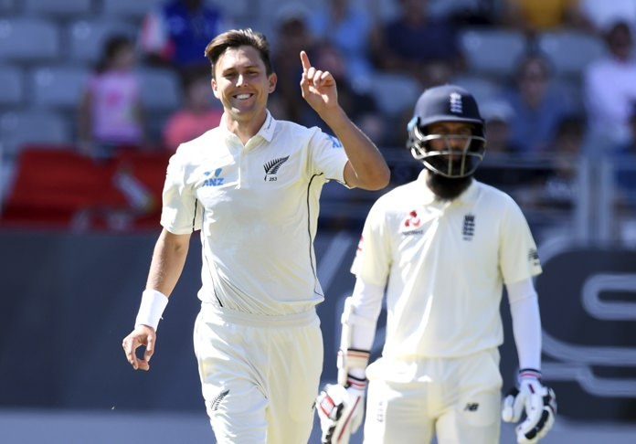 New Zealand's Trent Boult signals his 5th wicket after dismissing England's Chris Woakes during the first test in Auckland, New Zealand, Thursday, March 22. (AP Photo/Ross Setford)