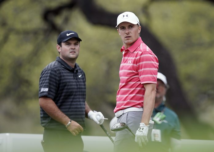 Jordan Spieth, right, watches his drive on the eighth hole as playing partner Patrick Reed looks on during round-robin play at the Dell Technologies Match Play golf tournament, Friday, March 23, in Austin, Texas. (AP Photo/Eric Gay)