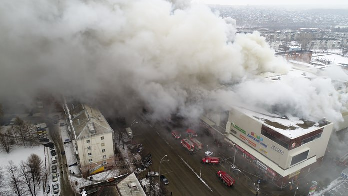 Smoke rises above a multi-story shopping center in the Siberian city of Kemerovo, Russia, Sunday, March 25. (Russian Ministry for Emergency Situations photo via AP)