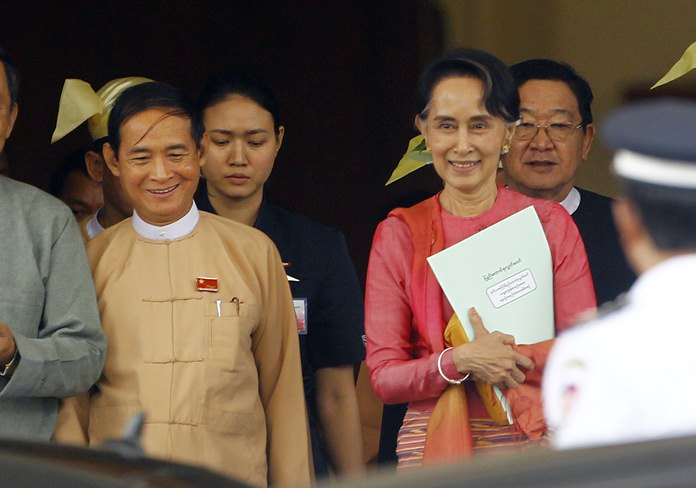 Win Myint, newly elected president of Myanmar, left, and Myanmar's leader Aung San Suu Kyi leave the parliament in Naypyitaw, Myanmar, in Naypyitaw, Myanmar, Wednesday, March 28. (AP Photo/Aung Shine Oo)