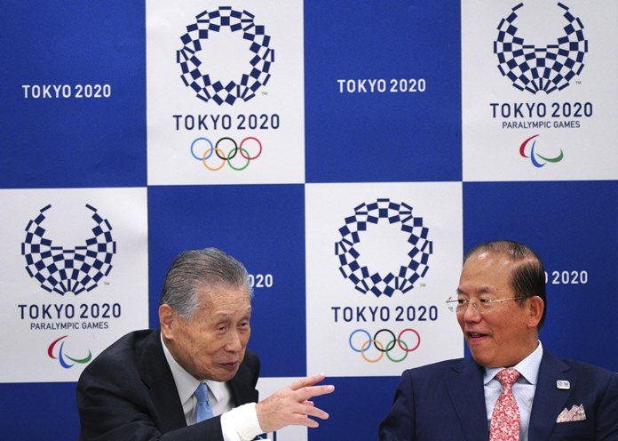 Tokyo 2020 Olympics President Yoshiro Mori, left, and Tokyo Organizing Committee CEO of the 2020 Olympics Toshiro Muto, right, chat prior to a meeting in Tokyo Wednesday, March 28. (AP Photo/Eugene Hoshiko)