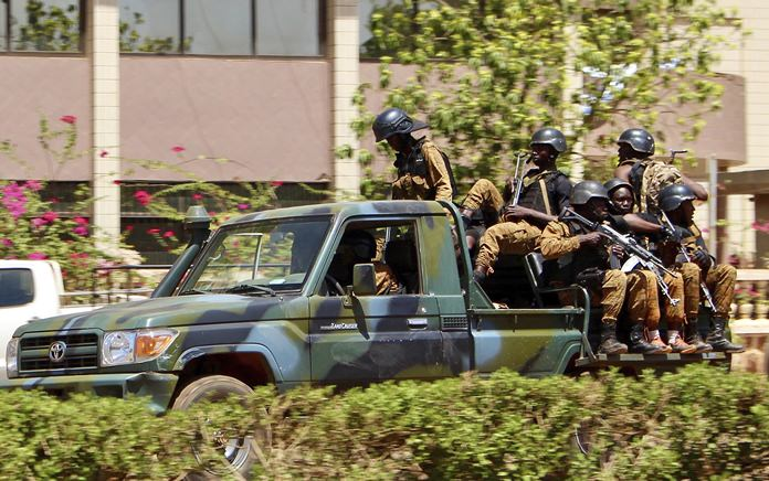 Troops ride in a vehicle near the French Embassy in central Ouagadougou, Burkina Faso, Friday March 2. (AP Photo/ Ludivine Laniepce)