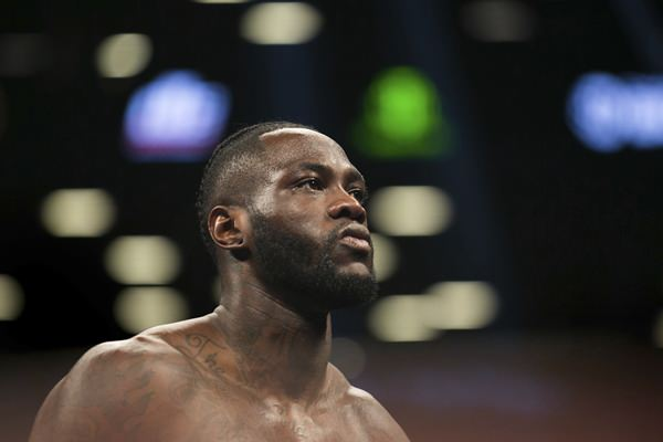 In this Nov. 4, 2017, file photo, Deontay Wilder paces the ring before a boxing bout against Bermane Stiverne, for the WBC heavyweight title, New York. (AP Photo/Kevin Hagen)