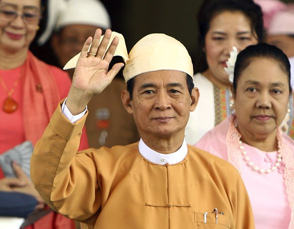 Myanmar's new President Win Myint waves to the media after taking an oath of office at Parliament in Naypyitaw, Myanmar, Friday, March 30. (AP Photo/Aung Shine Oo)
