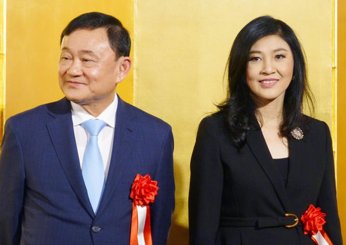 Former Prime Ministers Thaksin Shinawatra, left, and his sister Yingluck Shinawatra attend an event in Tokyo Thursday. March 29. (Kyodo News via AP)
