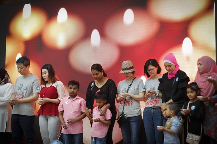 Relatives of passengers on board the missing Malaysia Airlines Flight 370 have a moment of silence during the Day of Remembrance for MH370 event in Kuala Lumpur, Malaysia, Saturday, March 3. (AP Photo/Vincent Thian)