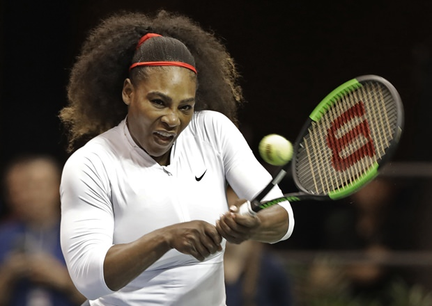 In this Feb. 11, 2018, file photo, United States' Serena Williams returns a shot against the Netherlands during the first round of Fed Cup tennis competition in Asheville, North Carolina. (AP Photo/Chuck Burton)