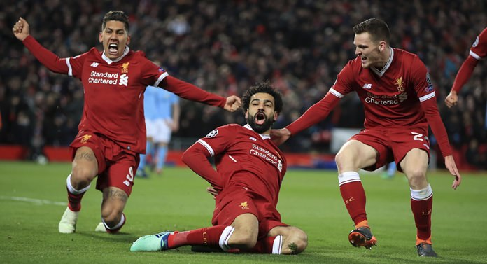 Liverpool's Mohamed Salah, center, celebrates with teammates after scoring his side's first goal of the game during the Champions League quarter final, first leg soccer match against Manchester City at Anfield Stadium in Liverpool, England, Wednesday, April 4. (Peter Byrne/PA via AP)
