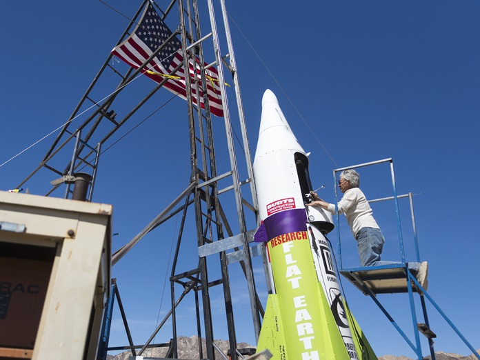 "In this March 6, 2018, file photo, ""Mad"" Mike Hughes begins work on repairing a steam leak after he scrubbed his launch attempt of his steam-powered rocket near Amboy, Calif. The self-taught rocket scientist who believes the Earth is flat propelled himself about 1,000 feet into the air before a hard-landing in the Mojave Desert that left him injured Saturday, March 24, 2018. Hughes tells The Associated Press that he injured his back but is otherwise fine after Saturday's launch near Amboy, Calif. (James Quigg/Daily Press via AP, File)"