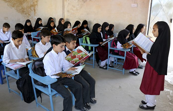 A Pakistani student teaches her class fellows at the school of Nobel Peace Prize winner Malala Yousafzai in her hometown of Swat Valley in Pakistan, Friday, March 30, 2018. (AP Photo/Naveed Ali)